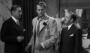 Sullivan (Joel McCrea in the middle) with his bosses