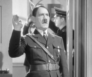 "An actor (Tom Dugan) saying ""Heil myself"" as Hitler in a doomed production."