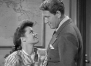 Hepburn flirting in her office after her male secretary ushers in her crush (Spencer Tracy)