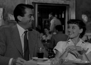 Drinking champaign for breakfast (Hepburn with Peck)