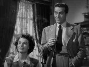 Ray Milland and Ruth Hussey as the Fitzgeralds
